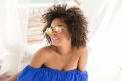 Happy youthful mulatto lady spending time on beach Stock Image