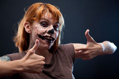 Happy zombie girl showing thumbs up Stock Image