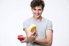 Happyman holding apple and donut Stock Photography