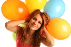 Happyness. Happy cute woman with balloons Royalty Free Stock Image