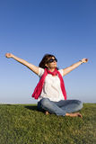 Happyness. Beautiful woman enjoying life with her arms outstretched Stock Photos