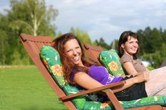 Happyness. Two young girls relaxing outdoors Royalty Free Stock Photos