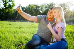 Happyness couple. Happiness couple in love with digital camera smiling Stock Photography