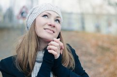 Happyness. Happy girl smiling, her hands pressed together Stock Images