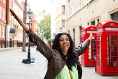 Happyness. Happy woman with arms outstretched in London Royalty Free Stock Image