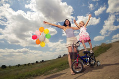 Happyness. Wiew of happy mother with little girl playing with balloons Stock Image