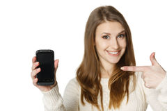 Happywoman pointing at her mobile phone Stock Photo