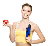 Happywoman with red apple and skipping rope Stock Photo