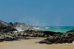 Beach waves rocks Hawaii Stock Images