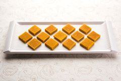 Hapus Amba Vadi / Burfi or Alphonso mango dried Cake or Bar, selective focus. Served in a plate over decorative background Stock Image