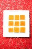 Hapus Amba Vadi / Burfi or Alphonso mango dried Cake or Bar, selective focus. Served in a plate over decorative background Stock Photo