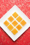 Hapus Amba Vadi / Burfi or Alphonso mango dried Cake or Bar, selective focus. Served in a plate over decorative background Royalty Free Stock Photos