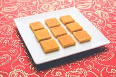 Hapus Amba Vadi / Burfi or Alphonso mango dried Cake or Bar, selective focus. Served in a plate over decorative background Royalty Free Stock Photography