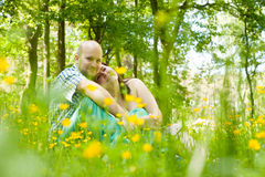 Hapy couple and flowers Royalty Free Stock Photos