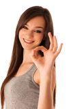 Hapy hispanic woman showing ok gesture with thumb up Royalty Free Stock Photo