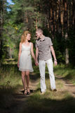 Hapy Young Couple Walking in forest Stock Images