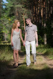 Hapy Young Couple Walking in forest Stock Photos