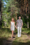 Hapy Young Couple Walking in forest Stock Image