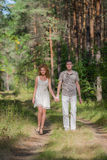 Hapy Young Couple Walking in forest Royalty Free Stock Image