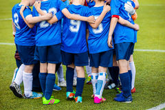 Hapy young football soccer team with coach standing together Stock Image