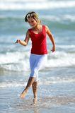 Hapy young woman on the beach Stock Images