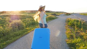 Hapy young woman with suitcase. Travel concept. Hapy young woman traveler with suitcase. Travel concept stock footage