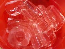 Is har hål på det röda området arkivfoton