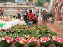 Har Ki Paudi, Haridwar, India. This is Har ki Paudi, one of the most important pilgrims in India and on Ganges. A local sell flowers and light of various sizes Royalty Free Stock Photo