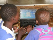 African school children using Sumsung laptop. Harare,Zimbabwe, Circa,September 2014.Two primary schoolkids whilst using a sumsung laptop at school stock image
