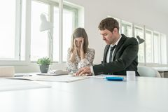 Harassed businesswoman checking the accounts Royalty Free Stock Photo