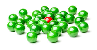 Harassment. Concept with red and green marbles -  Harassment Royalty Free Stock Photo