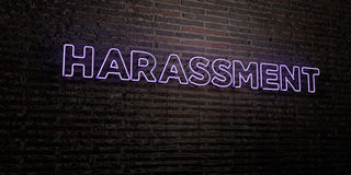 HARASSMENT -Realistic Neon Sign on Brick Wall background - 3D rendered royalty free stock image Stock Photo