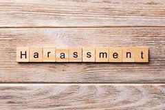 Harassment word written on wood block. harassment text on wooden table for your desing, concept royalty free stock image