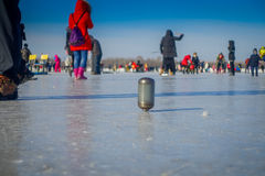 Harbin, China - February 9, 2017: Spinning top on ice on frozen river Songhua during winter time. Stock Photos