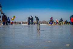 Harbin, China - February 9, 2017: Spinning top on ice on frozen river Songhua during winter time. Stock Images