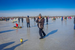 Harbin, China - February 9, 2017: Spinning top on ice on frozen river Songhua during winter time. Stock Image