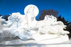 Harbin, China - January 2015: International Snow Sculpture Art Expo. Harbin, China - January 2015: Snow sculpture of wolves in the 27th China Harbin Sun Island Stock Image
