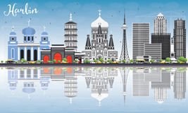 Harbin Skyline with Gray Buildings, Blue Sky and Reflections. Stock Photo