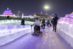 Harbin Zamraża festiwal 2018 - å 'ˆå°' æ' ¨å› ½ é™… å † °é› ªèŠ 'lodowi i śnieżni fantastyczni budynki, zabawa, sanna, noc, podró Fotografia Stock