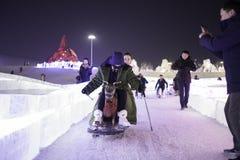 Harbin Zamraża festiwal 2018 - å 'ˆå°' æ' ¨å› ½ é™… å † °é› ªèŠ 'lodowi i śnieżni fantastyczni budynki, zabawa, sanna, noc, podró Obraz Royalty Free