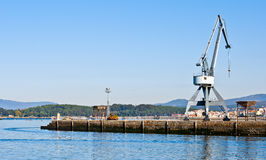 Harbor. Commercial port with a crane Royalty Free Stock Images
