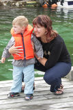At the harbor. Mother and her son are looking at the boats in Norway Royalty Free Stock Photo