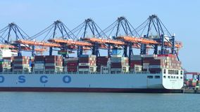 Harbor Activity. ROTTERDAM, NETHERLANDS - 24 JUNE 2015: Timelapse of a large container ship being unloaded in Rotterdam Harbor, with a supply vessel moored stock video