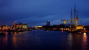 The harbor from Amsterdam in the Netherlands by night stock footage