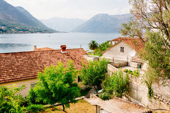 Harbor and ancient buildings in sunny day at Boka Kotor bay Montenegro, Europe. Royalty Free Stock Photo