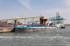 Harbor Antwerp with bargo moored at a quay with coal handling Stock Photography