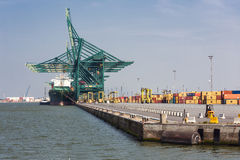 Harbor of Antwerp with port cranes and big freight carriers Stock Photos
