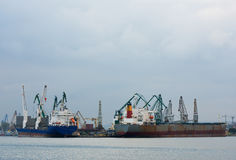 Harbor area with ships. Cargo industry Royalty Free Stock Images