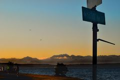 Harbor Ave Mountain Fog. A scenic view of the Olympic Mountains with Evening fog along the foothills taken from Harbor Ave in Seattle, WA royalty free stock photography