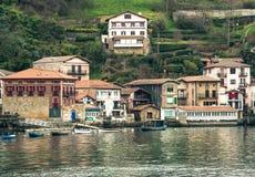 Harbor of basque village Pasaia, Spain. A view of basque village Pasaia, Spain with turquoise water stock image